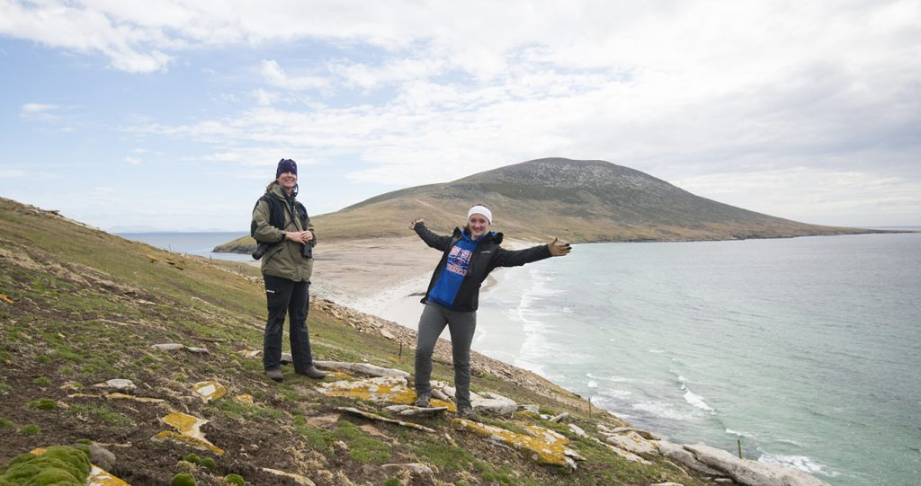Students standing on coastline of Falkland Islands
