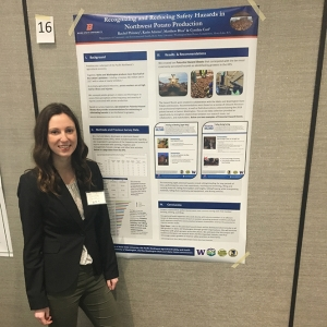 Rachel Phinney next to her research poster