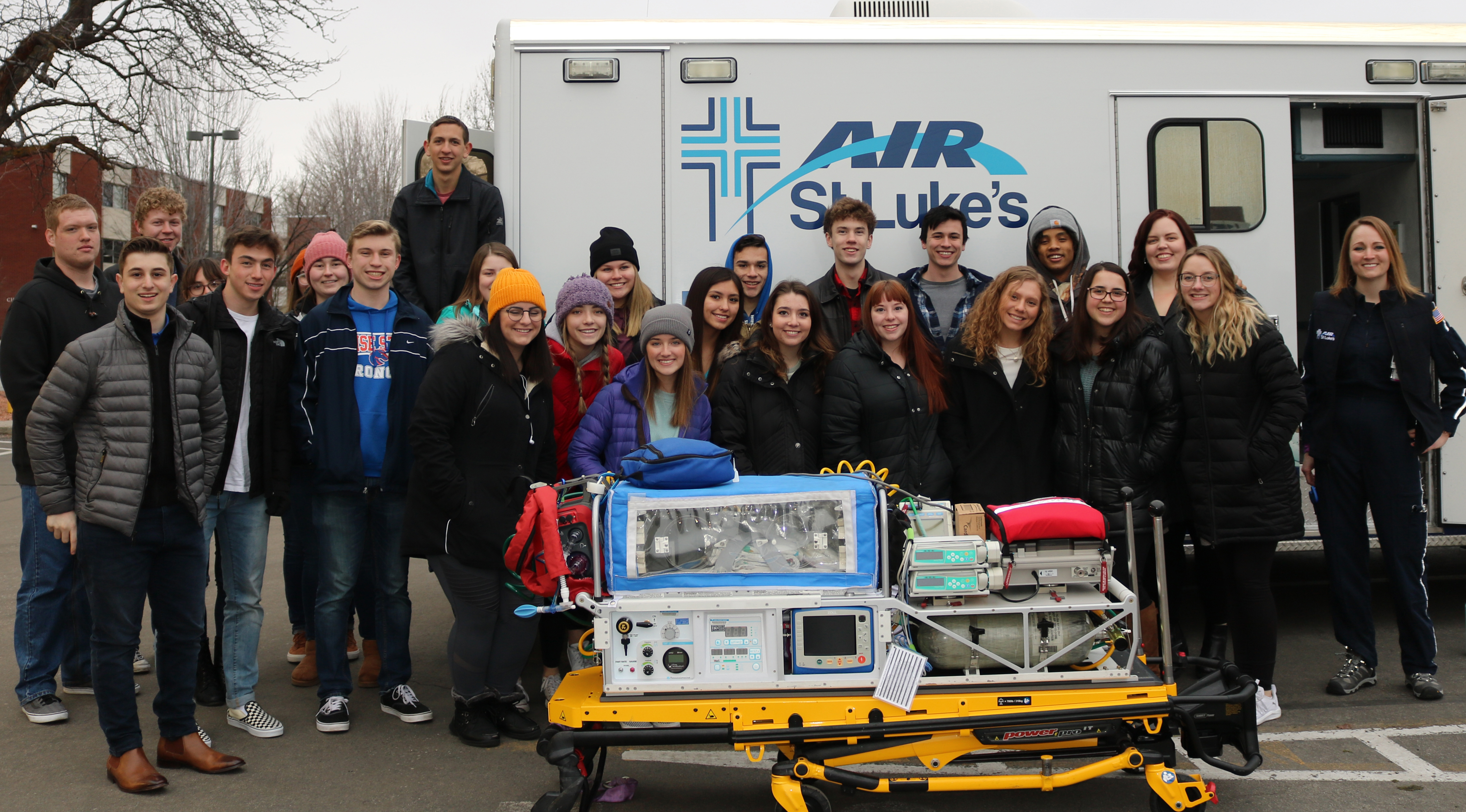 HP LLC entire class standing infront of Air St. Luke's Ambulance