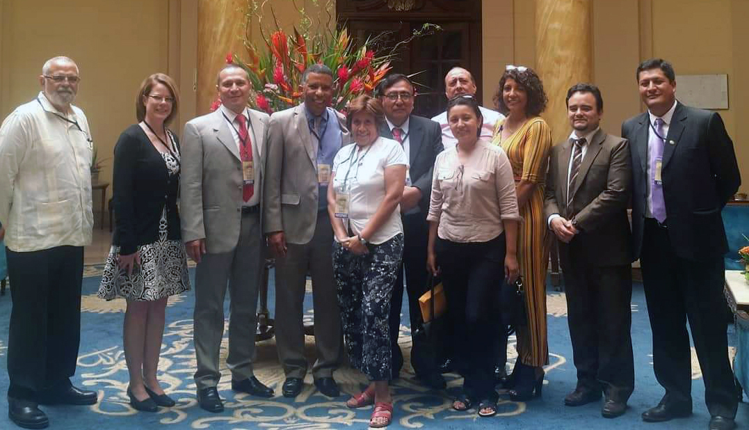 Leslie standing with other members of the conference in Peru