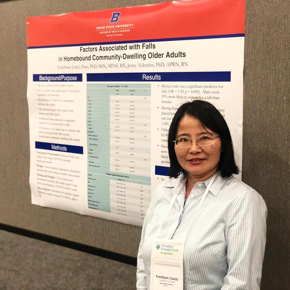 Lucy Zhao with research poster at conference