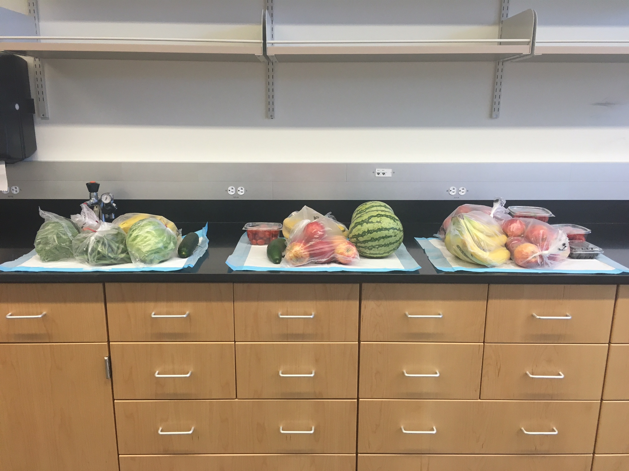 Photo of a counter with fruits and vegetables on it