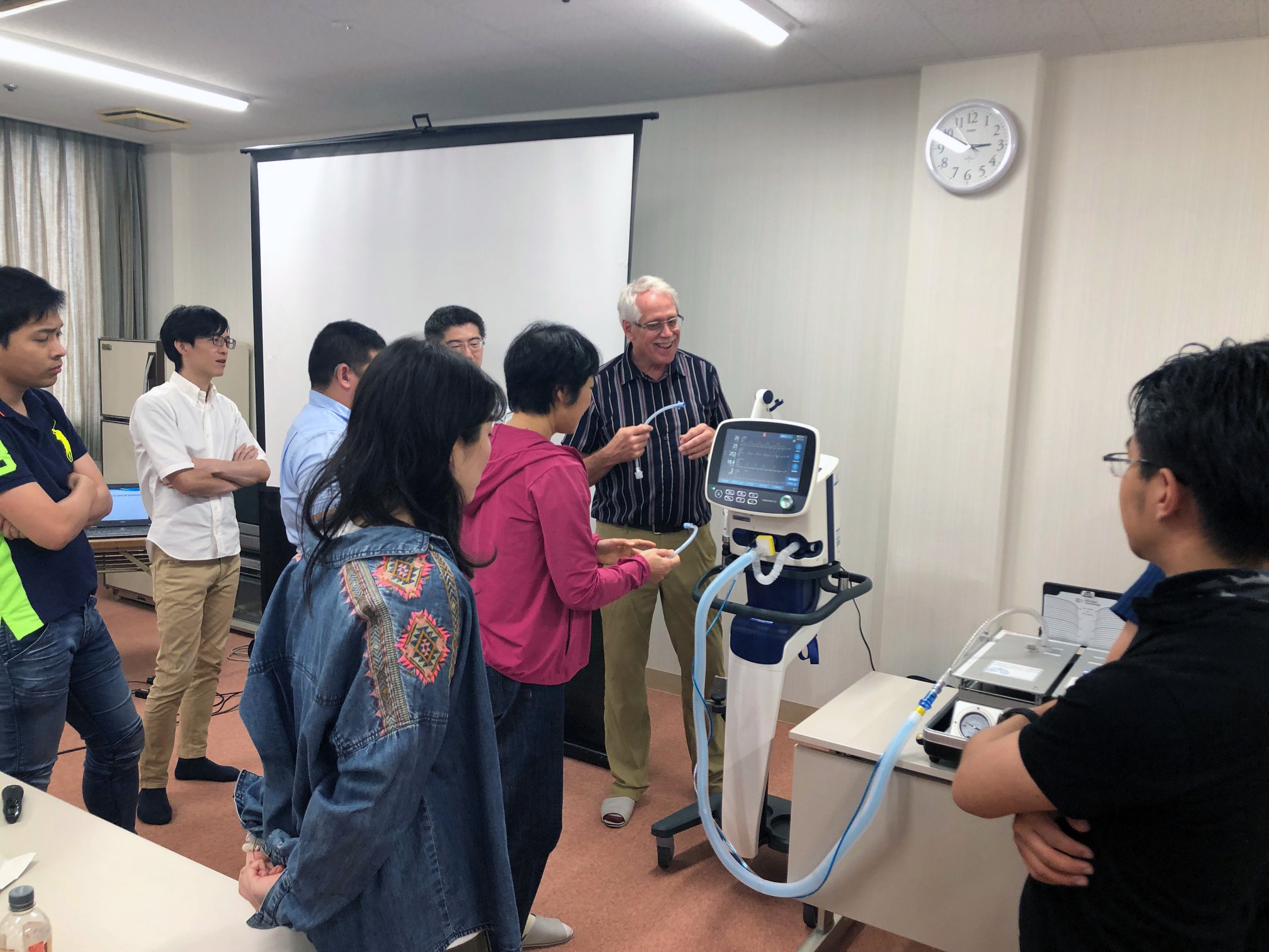Ashworth teaching students how to use a ventilator