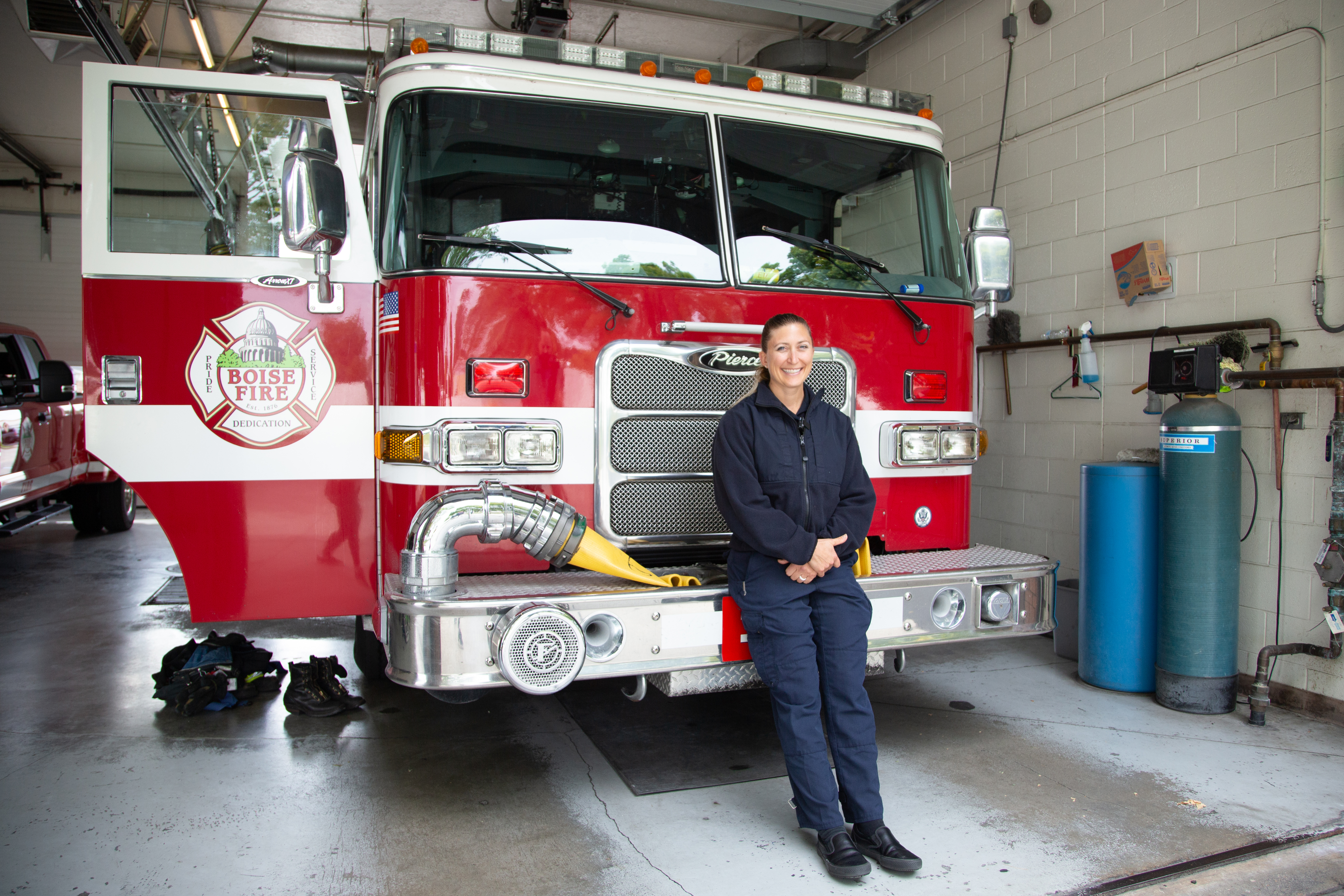 Captain Ashley Rosenbaum at Fire Station 11, Boise, ID. Rosenbaum is the first female captain of the Boise Fire Department and a graduate of the Boise State Public Health program. Photo by Arlie Sommer, Boise State Extended Studies.