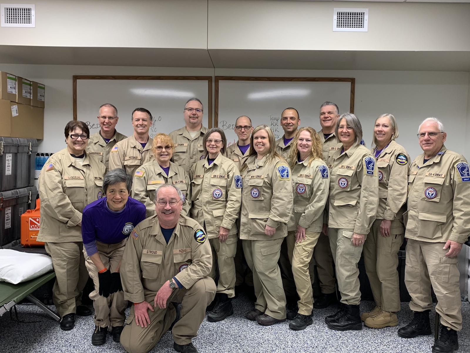 Jamie Baxter (fifth from left) with her fellow National Disaster Medical System Disaster Medical Assistance Team members at the Camp Ashland Army National Guard Base near Omaha, Nebraska.