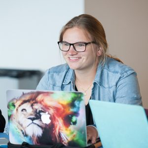 Boise State student visits with classmates