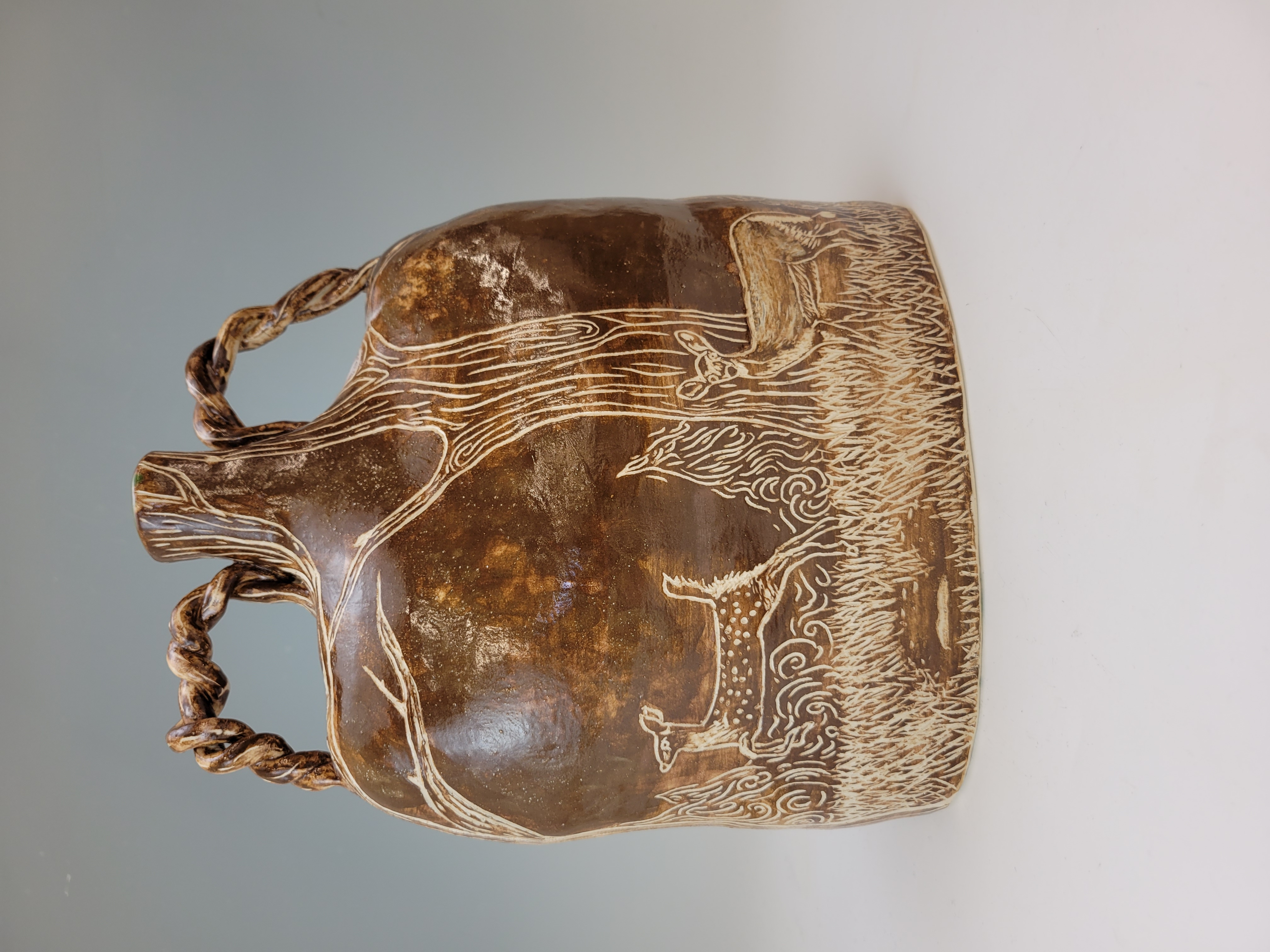 Image of the Giants of the Forest ceramic vase sculpture back.