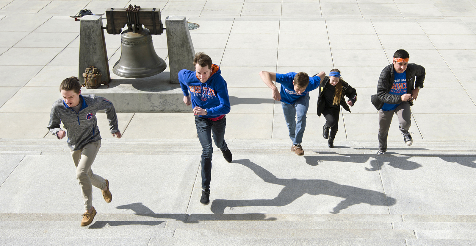 students running up capitol steps