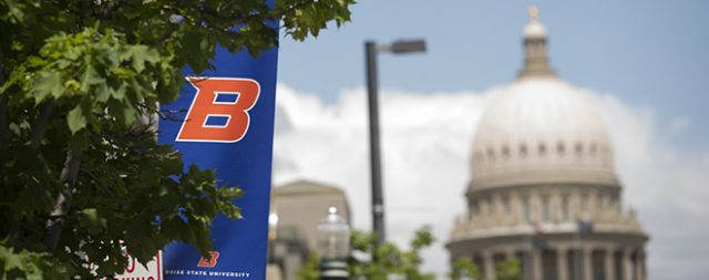 Photo of Idaho Capitol in background with Boise State Banner in foreground