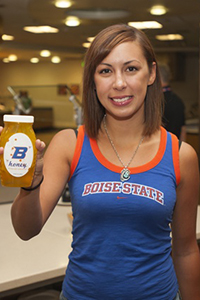 image of student with honey bottle