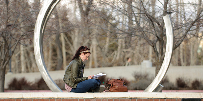photo of woman studying