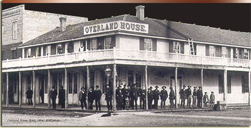 Boiseans crowd the corner of 8th and Main at the Overland House, an 1864 supply point on the gold road to Idaho City. Idaho State Historical Society.