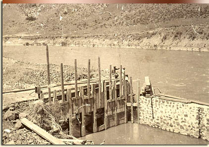Gravity canal irrigation remade the Treasure Valley in an agricultural powerhouse. Pictured: headgate of the New York Canal, about 1912. Ada County.