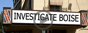 """theatre with """"Investigate Boise"""" on marquee"""