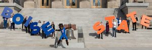 Buster Bronco and Students on capitol steps