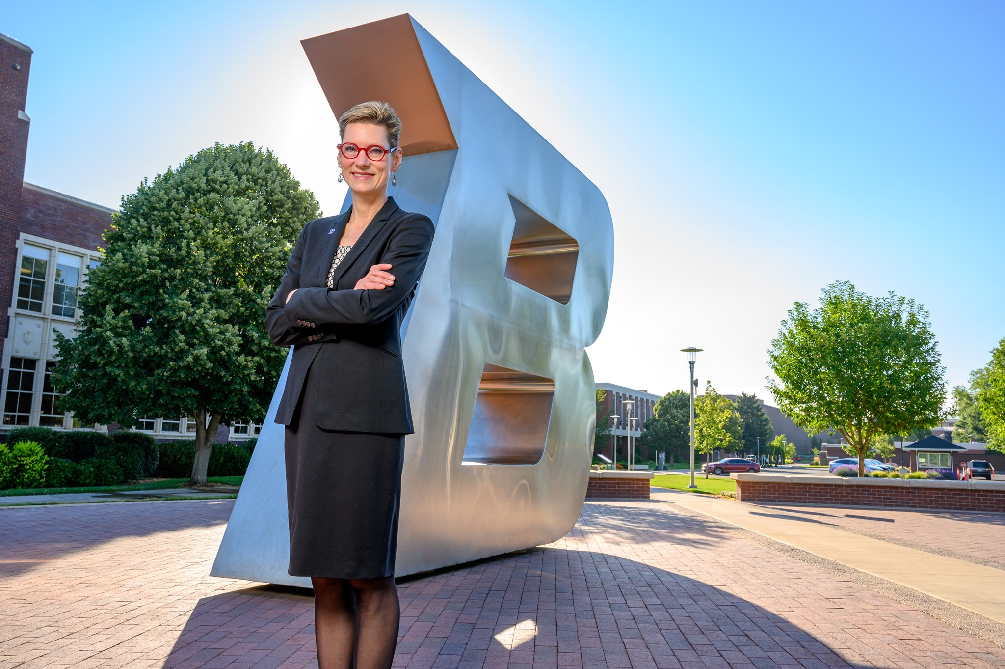 Dr. Tromp in front of the Boise State B sculpture