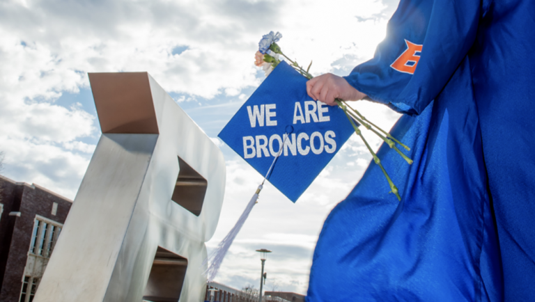 Boise. State graduate in front of the B