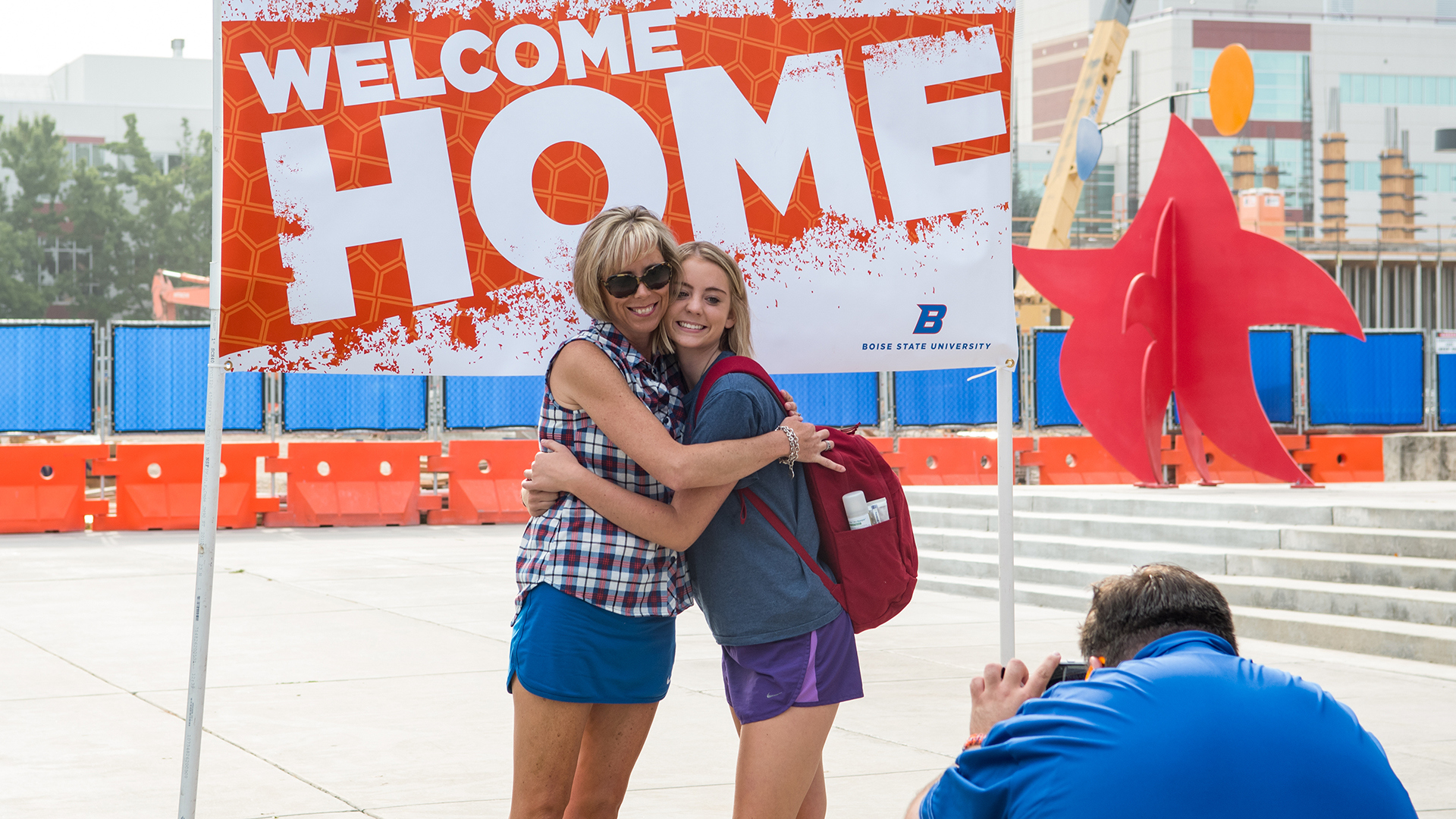 Two women hugging on move-in day