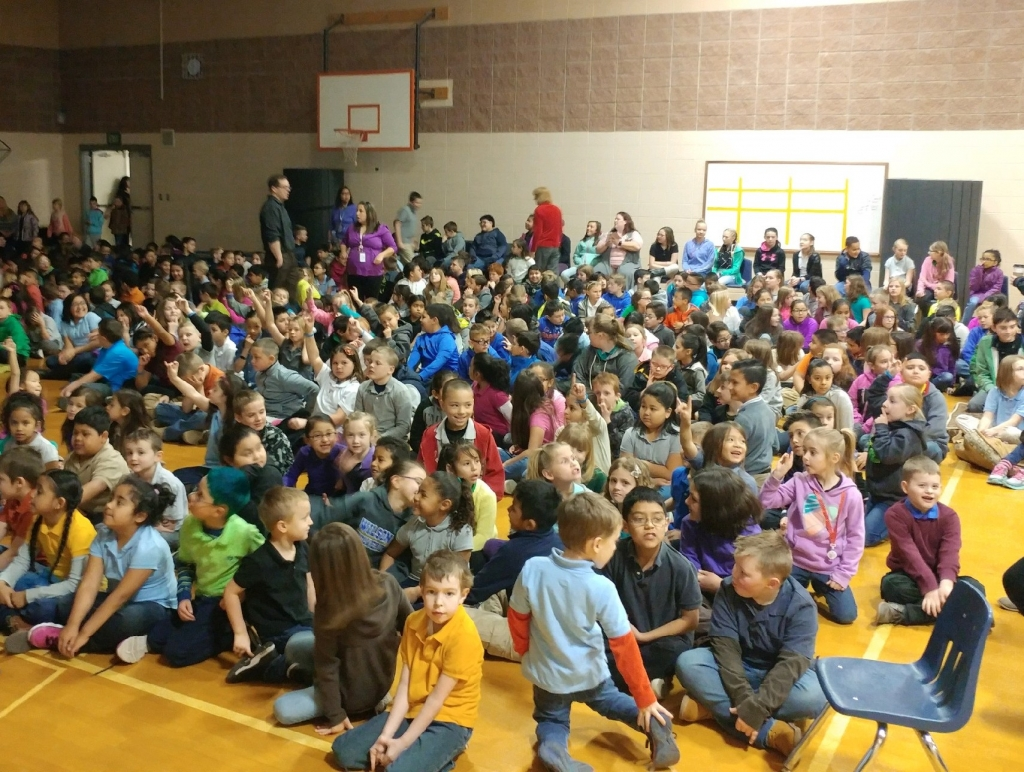 """450 Wilson Elementary students settle in for a """"Curlews in the Classroom"""" presentation"""