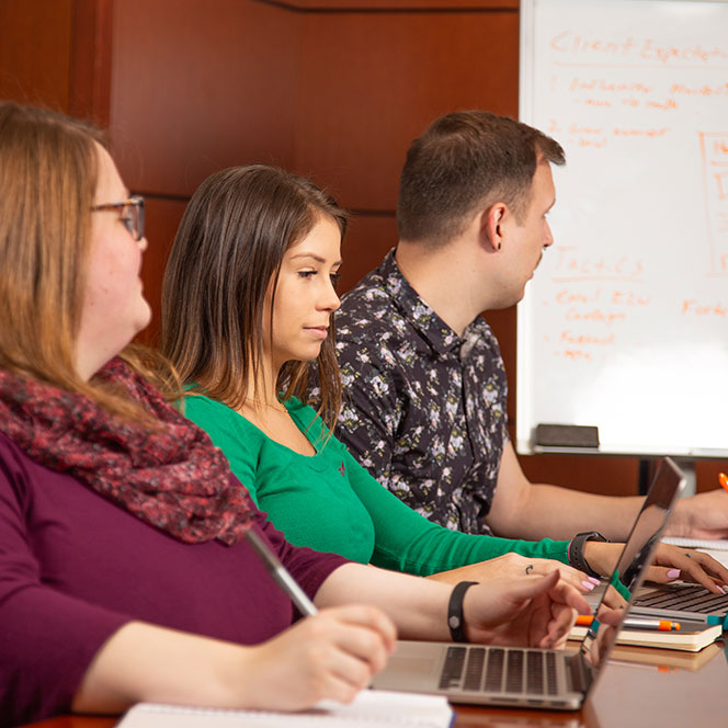 Students working in a conference room