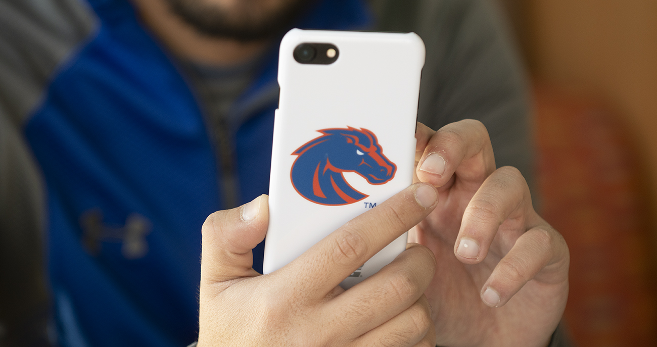 Boise State student using cell phone