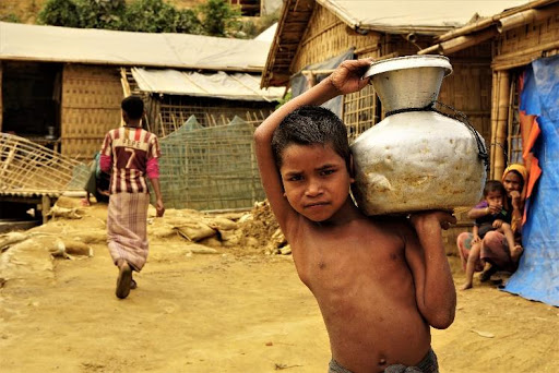 A child with clean water in a Rohingya camp