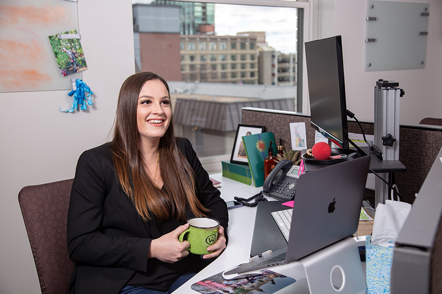 Sophia Hartsock sits at her desk at Red Sky.