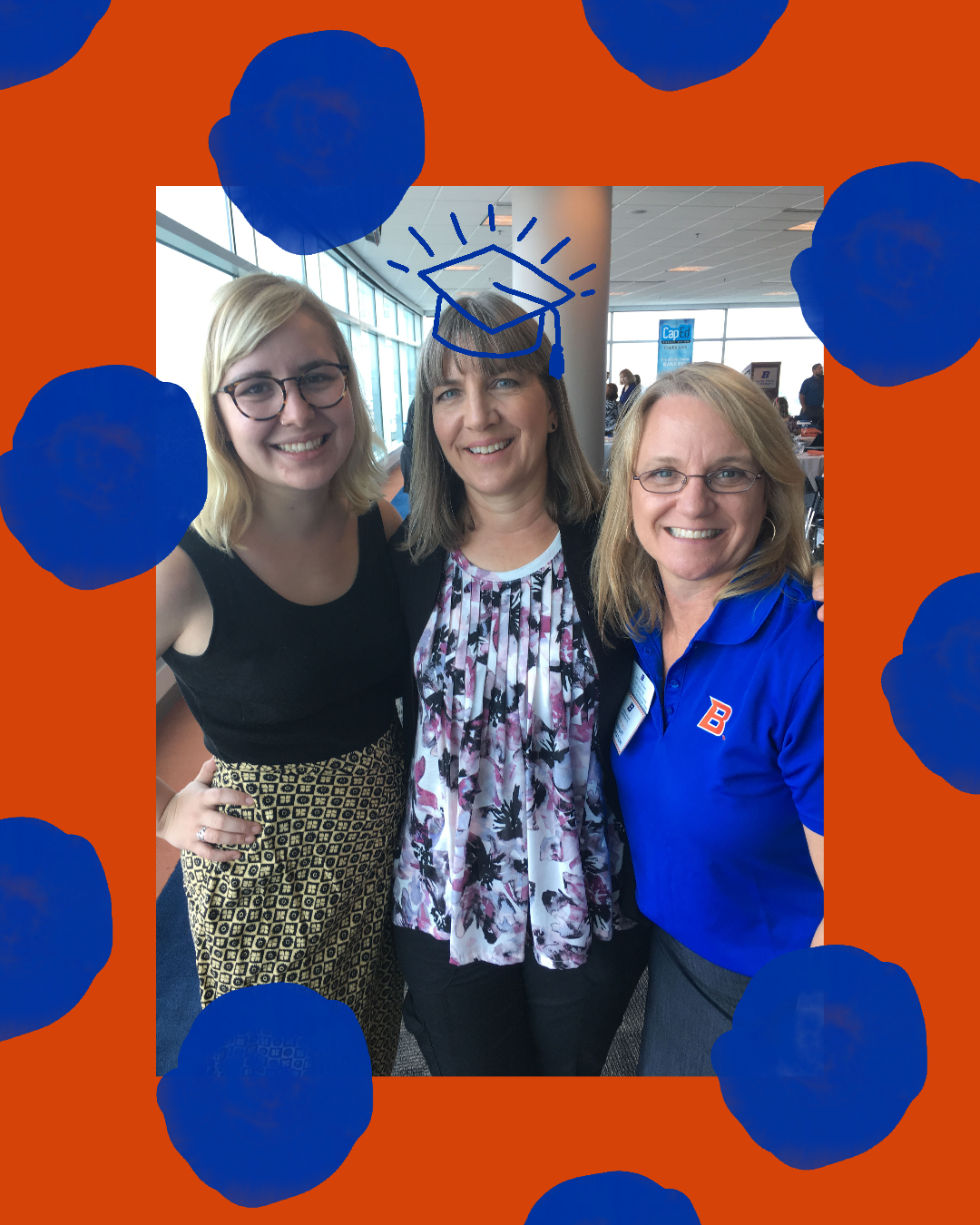 Kati Searles poses with her academic advisor and her daughter.