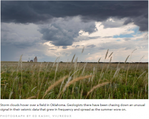 Photo of Storm clouds hover over a field in Oklahoma. Geologist there have been chasing down unusual signal in their seismic data that grew in frequency and spread as the summer wore on.