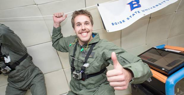 Microgravity Student Grinning in a Zero-Gravity chamber and giving a thumbs-up to the camera.