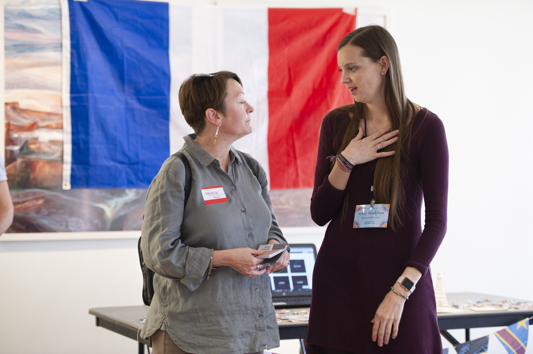 An attendee of the showcase speaking to a student