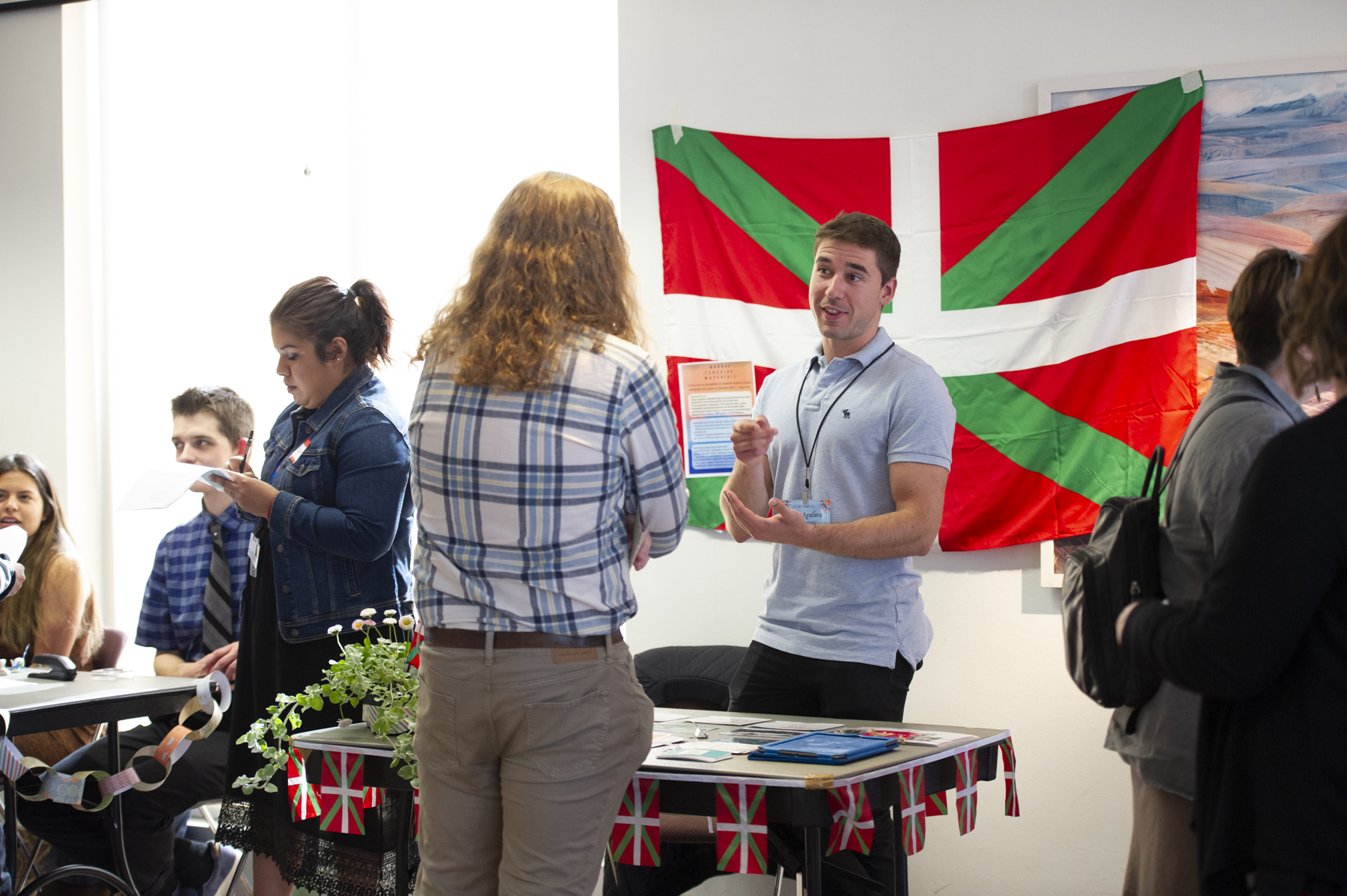 Student presenting his work to an attendee