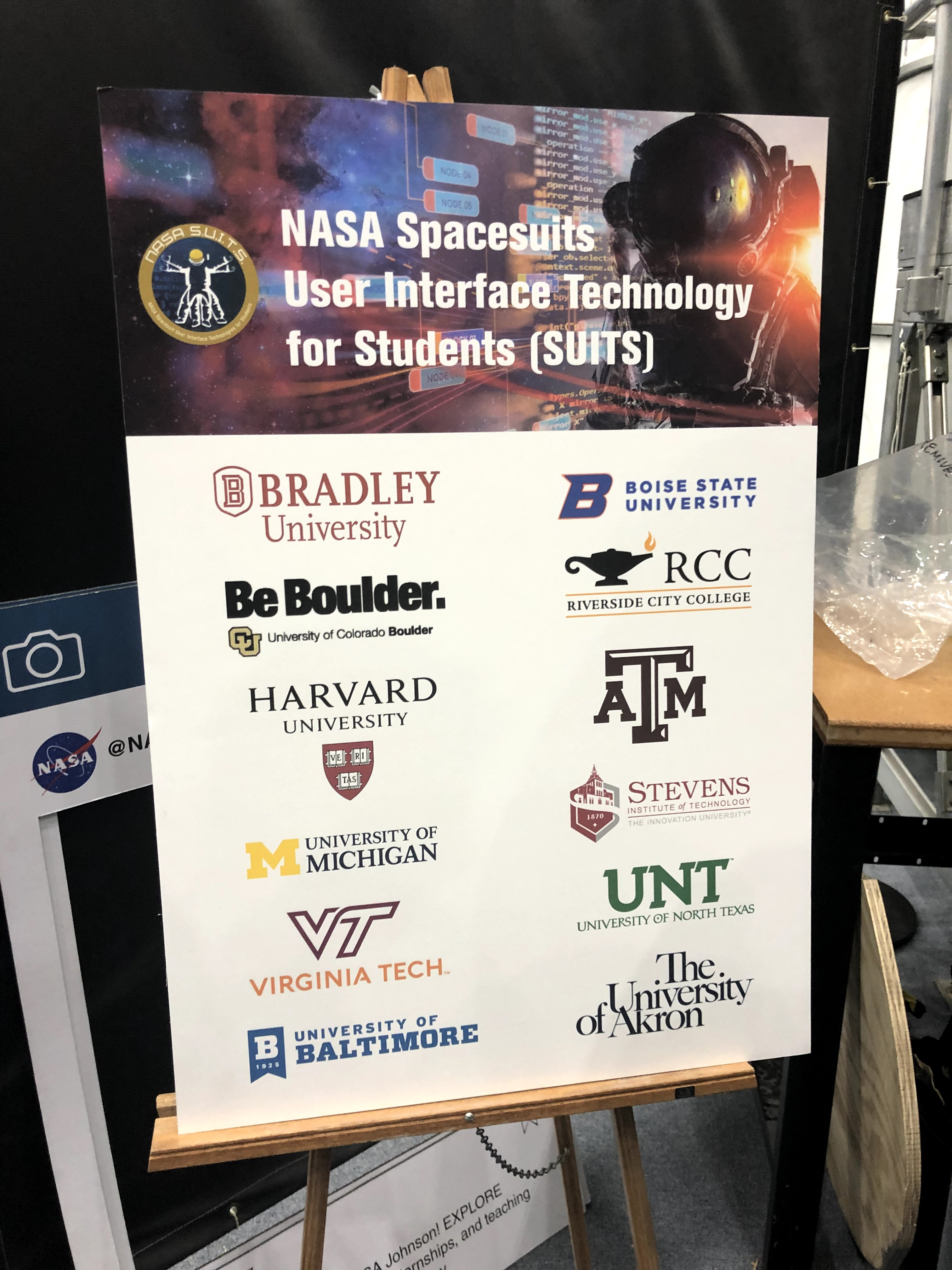 Image of Promotional Material at Johnson Space Center revealing the schools involved in the NASA Suits challenge. Boise State is listed among schools such as Harvard and Virginia Tech