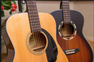 Two six-string guitars of the acoustic steel-string type