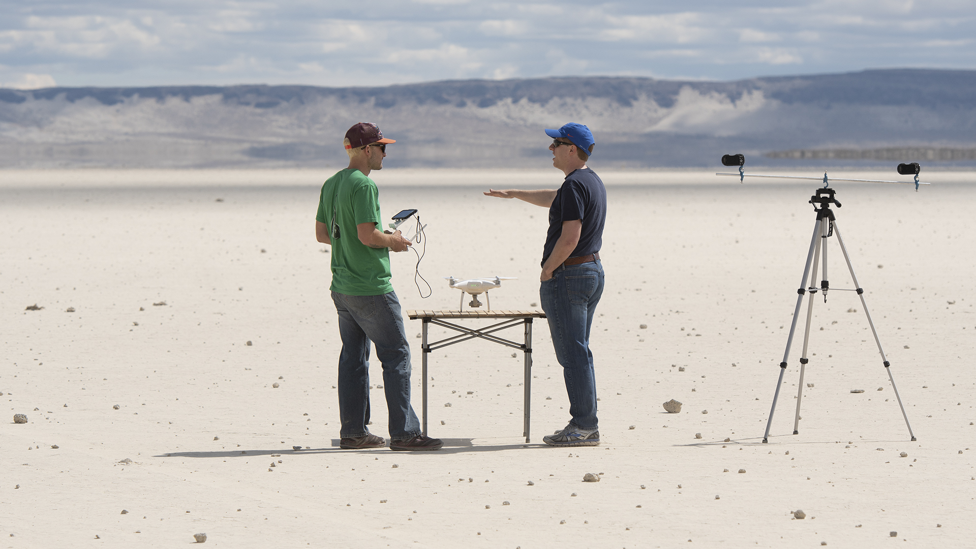 Researchers in dessert standing next to all the equipment