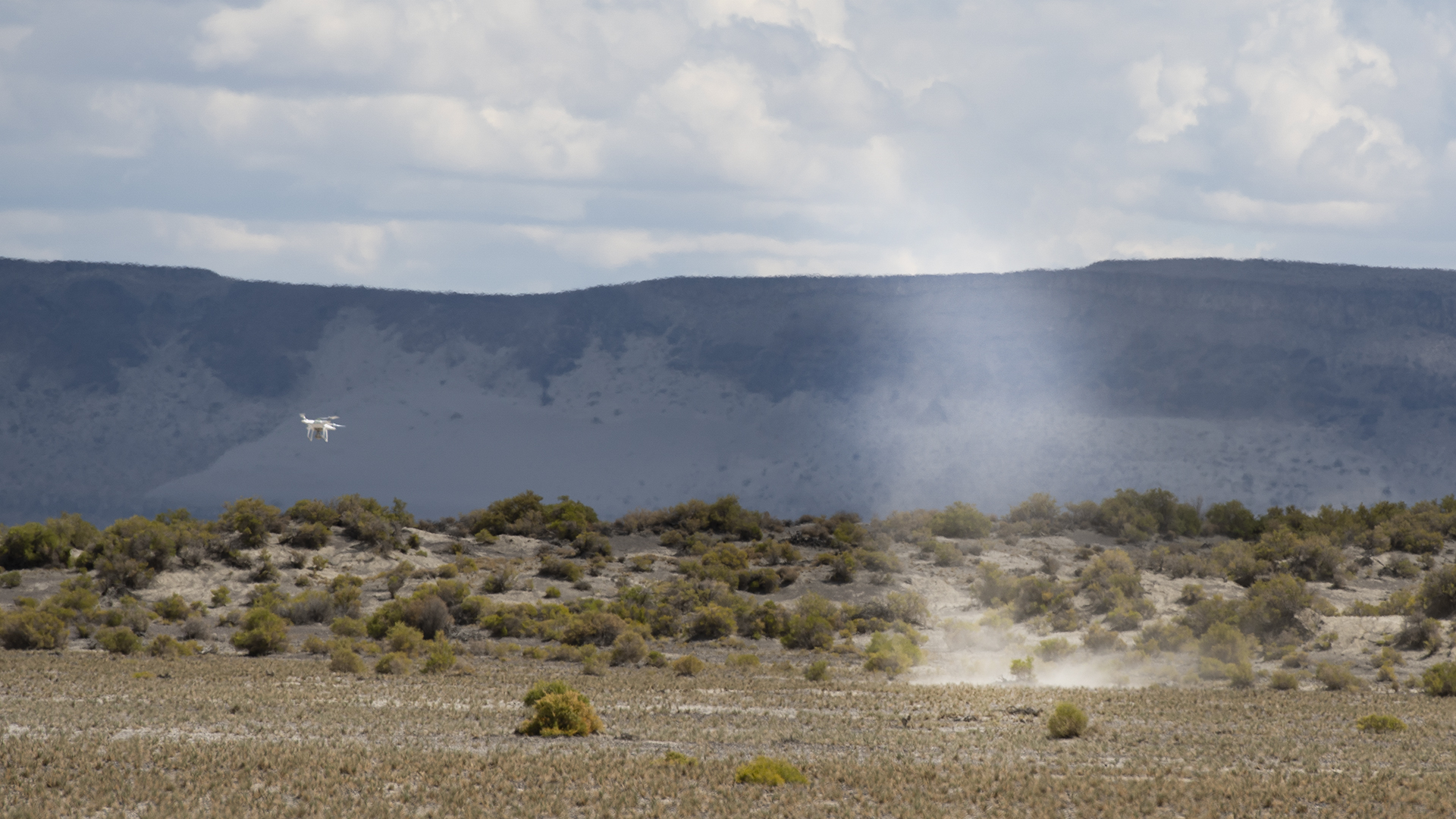 Dust devil traveling, drone beside it