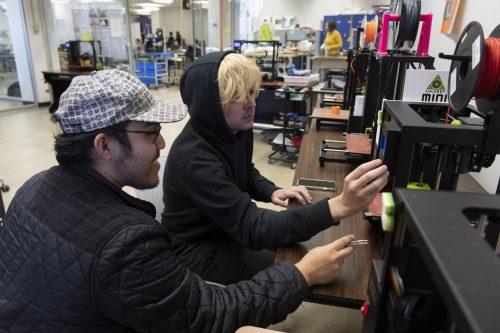 Lionel Lopez (left) and Brennon Leman work on a project to add scent to virtual augmented reality environments, photo Patrick Sweeney