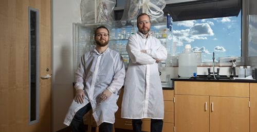 Corey Wall and Mark Schmitz pose for a photo inside the the Isotope Geology Lab