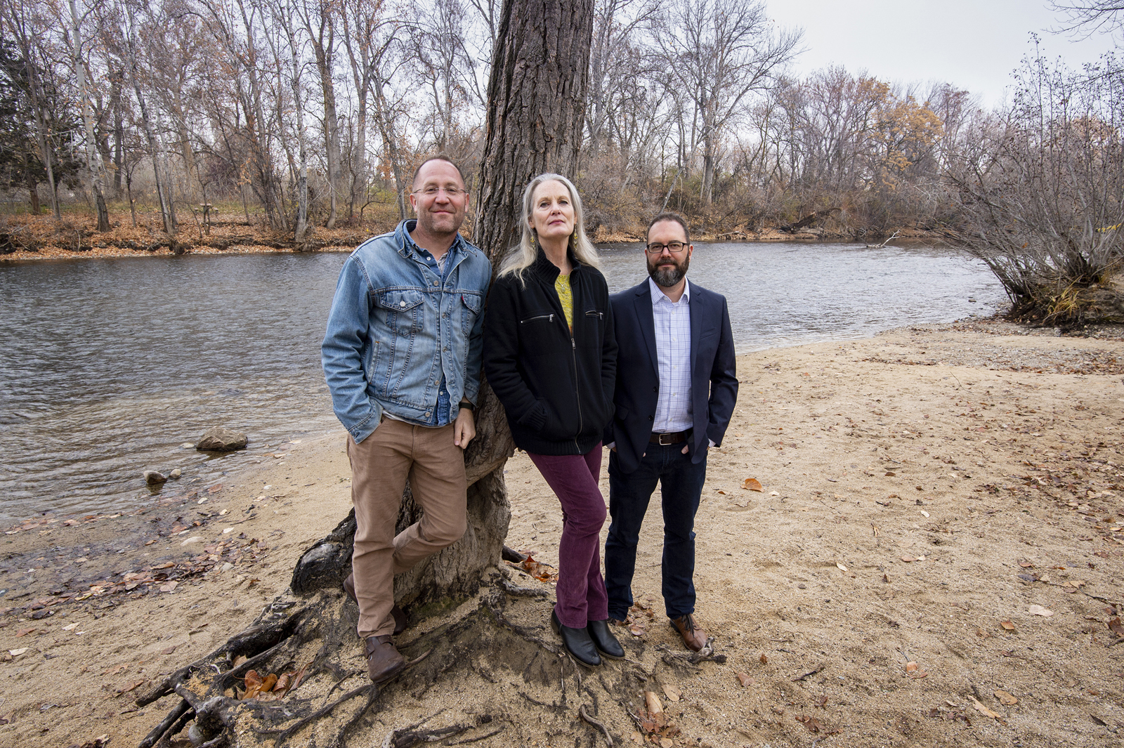 Three faculty standing next to Boise River