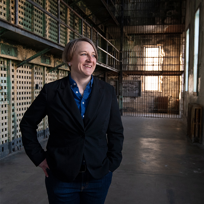 Historian Amber Beierle poses at the old penitentiary