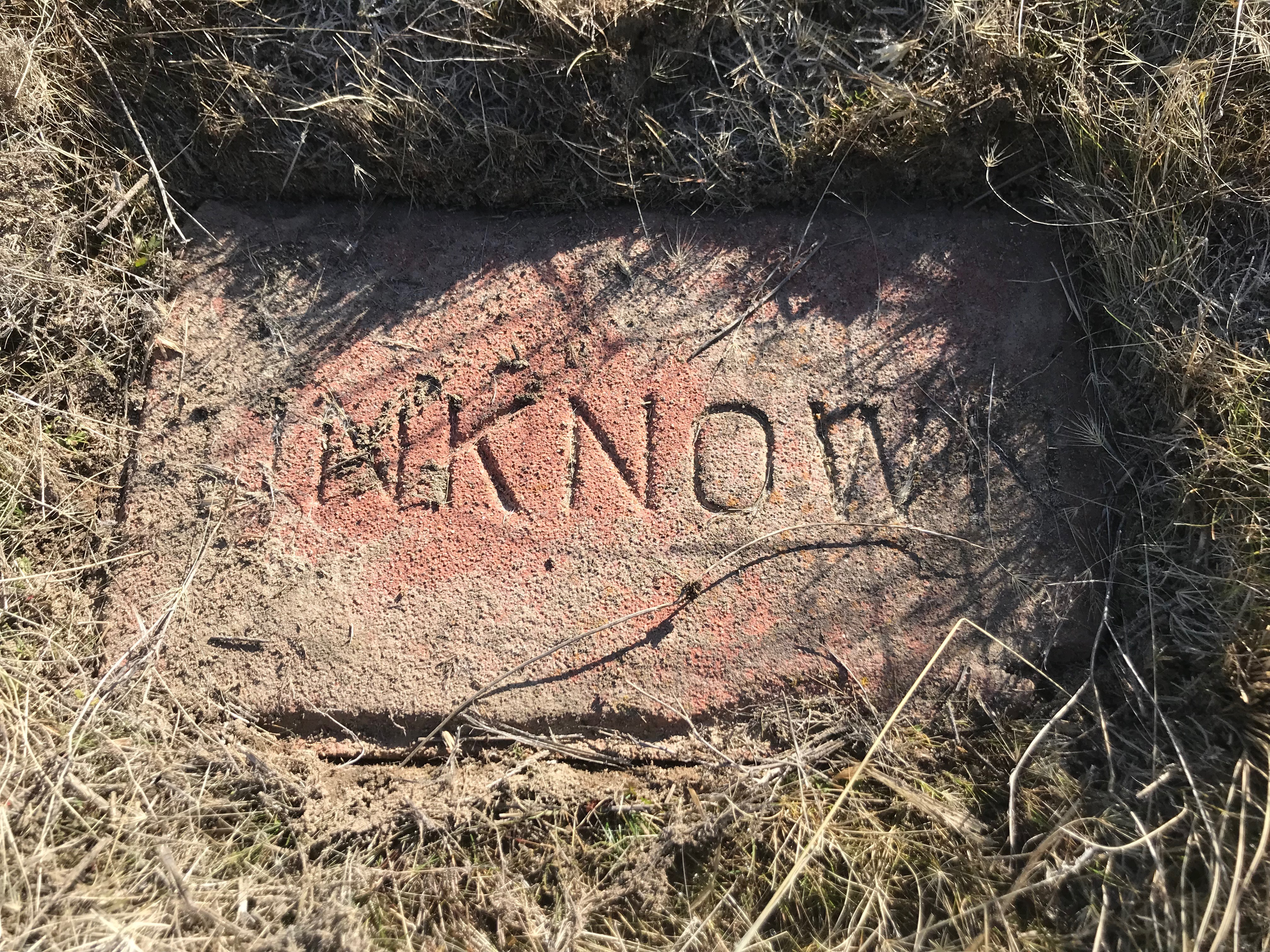 a stone marker from the Old Penitentiary cemetery.