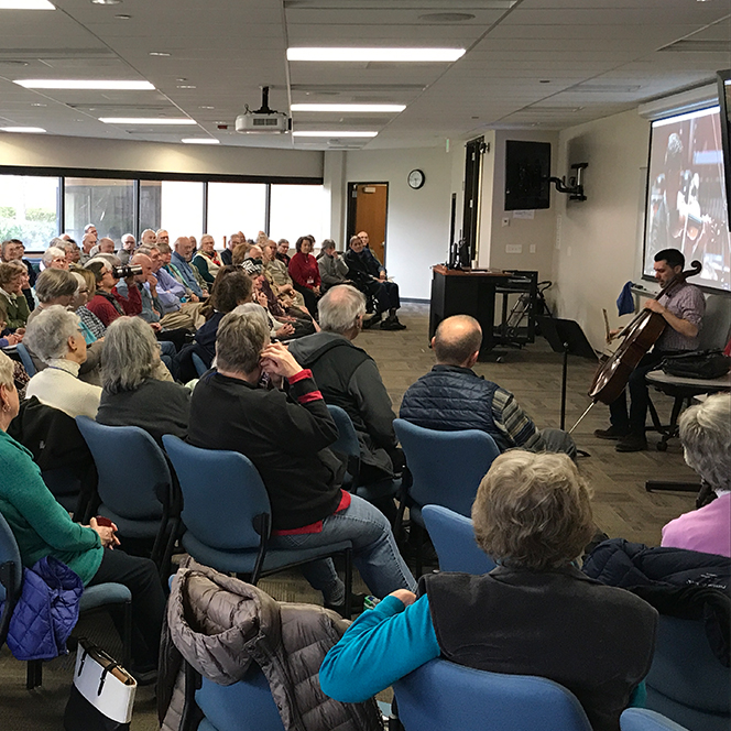 Brian Hodges plays the cello for Osher crowd