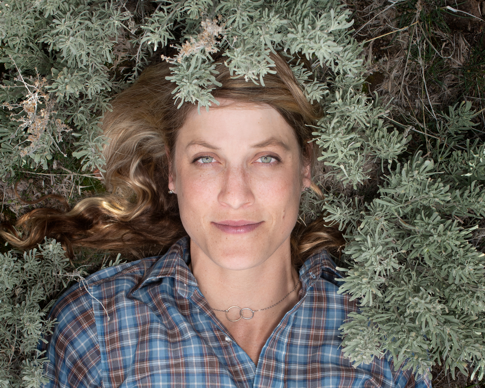 Martha Brabec portrait surrounded by sagebrush