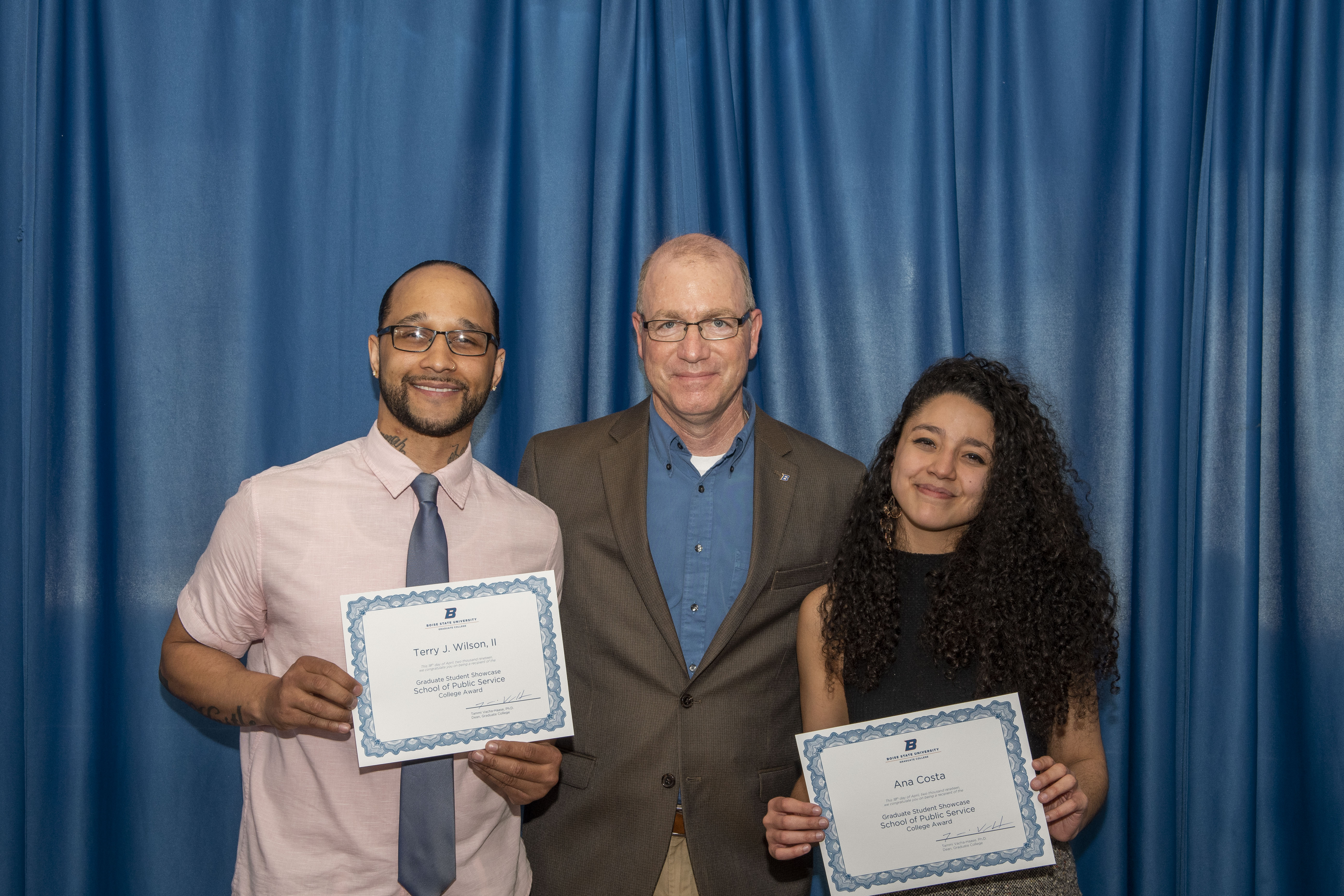 Graduate College Awards winners Terry Wilson and Ana Costa pictured with Dr. Andrew Giacomazzi