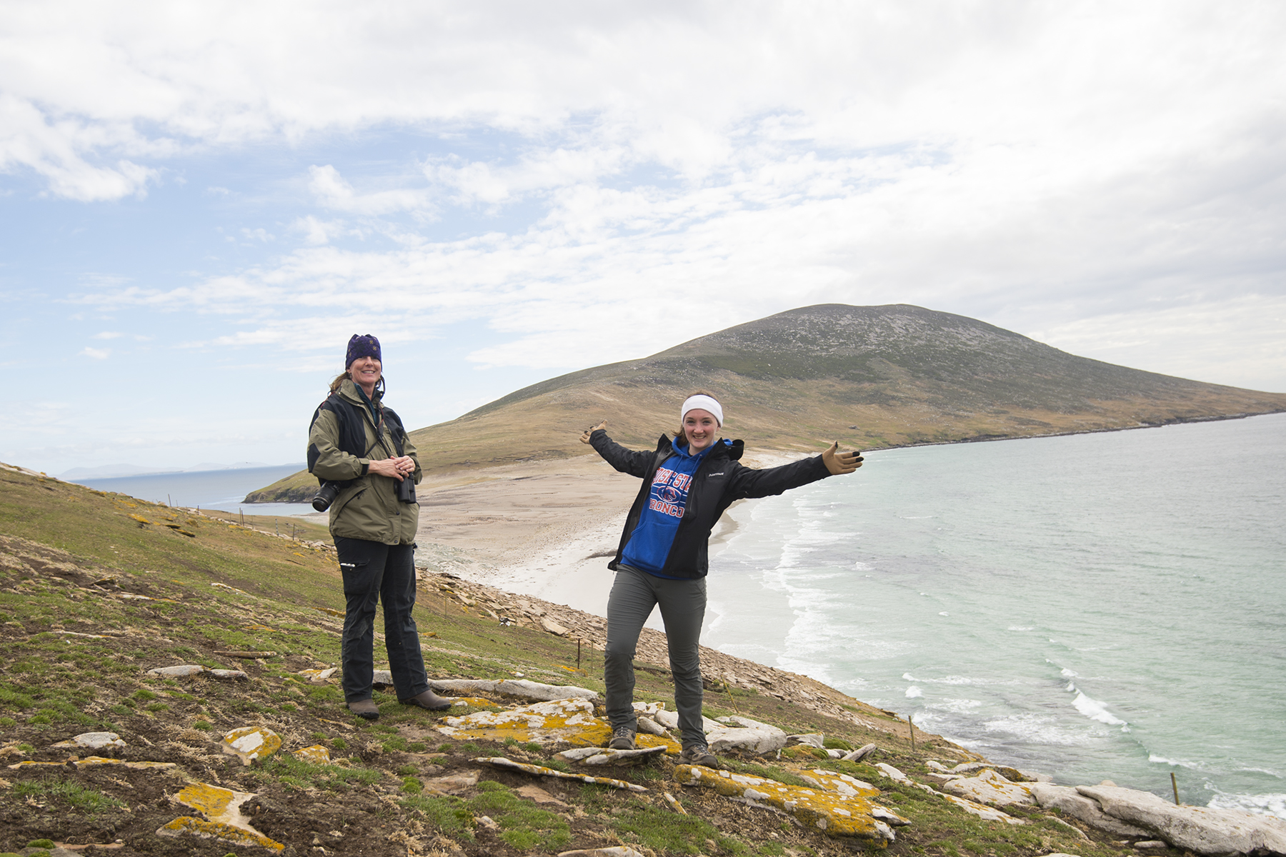 Biology students Gretel Care and Lauren Young, standing on Saunders Island,
