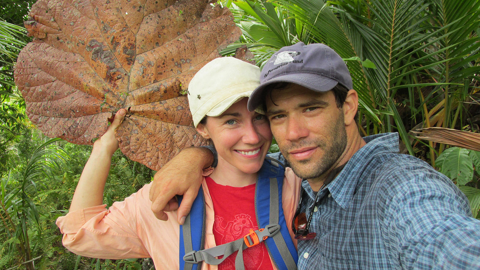 Photo of Christine and Thomas in Dominican Republic. Christine is holding an enormous leaf