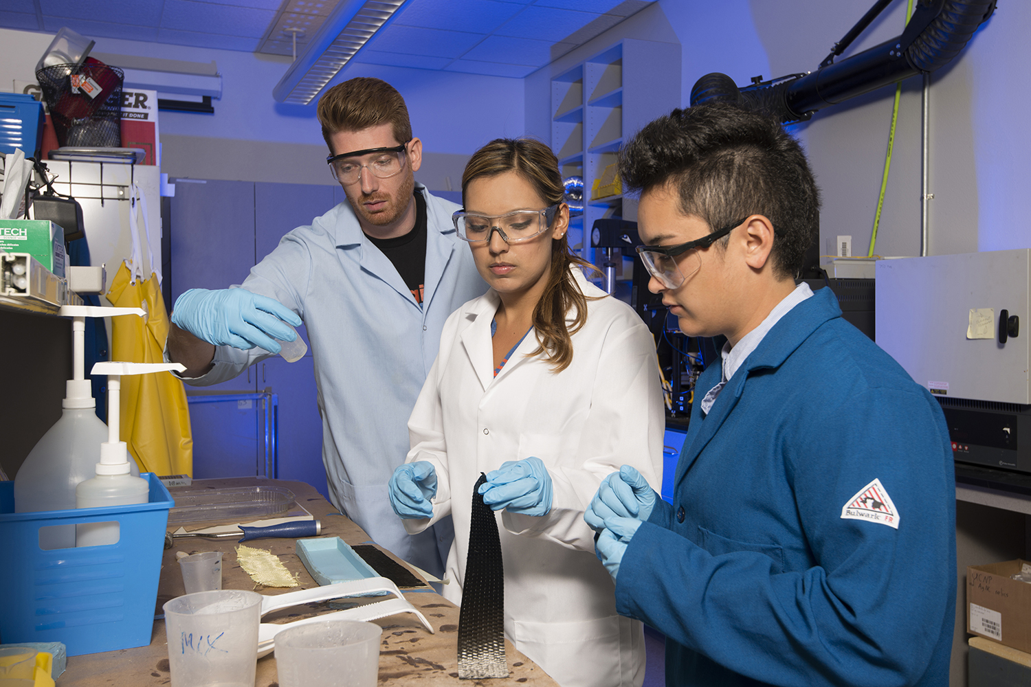 Photo of three people working in lab