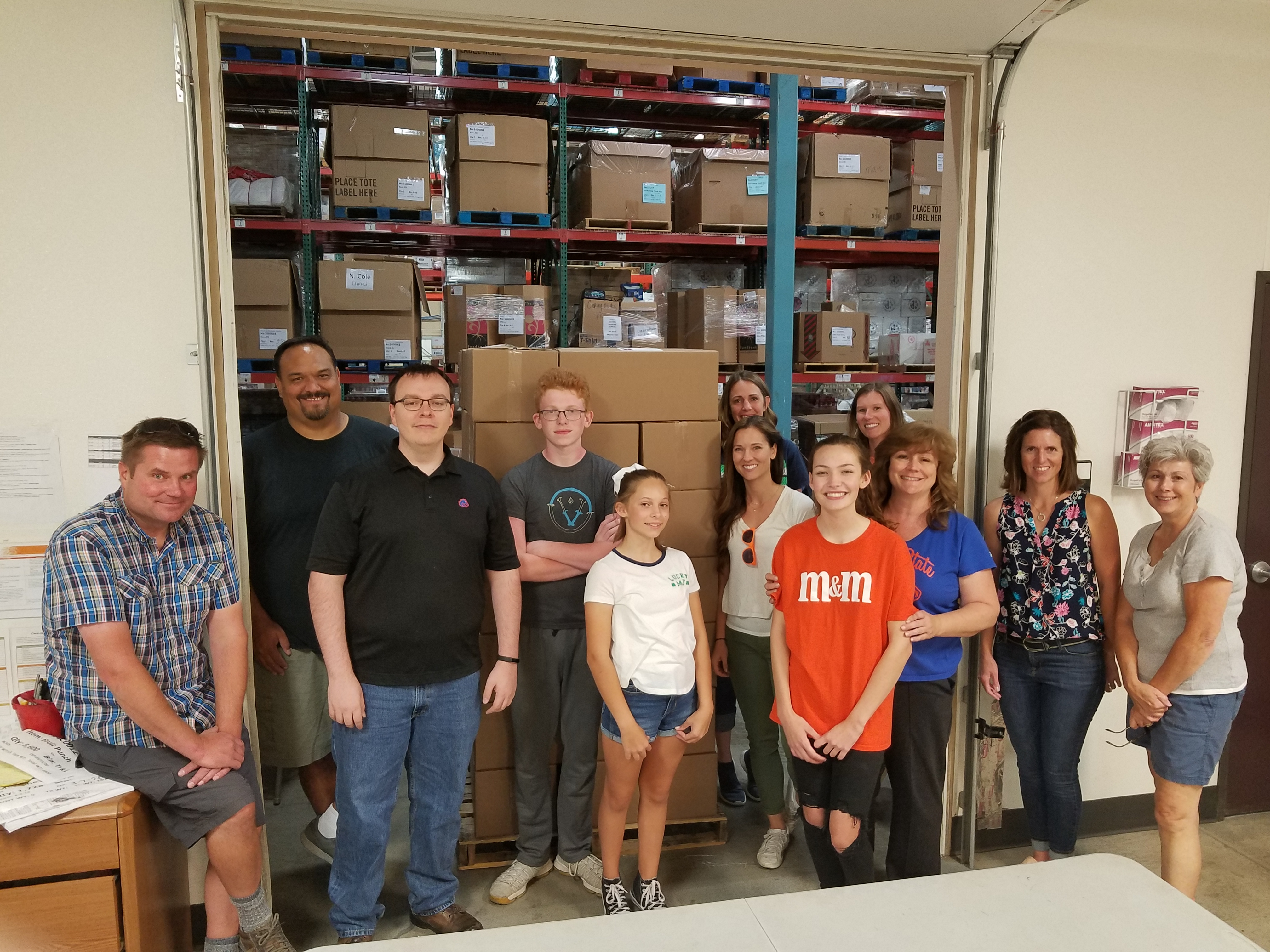Boise State employees pose at the Idaho Food Bank while volunteering.