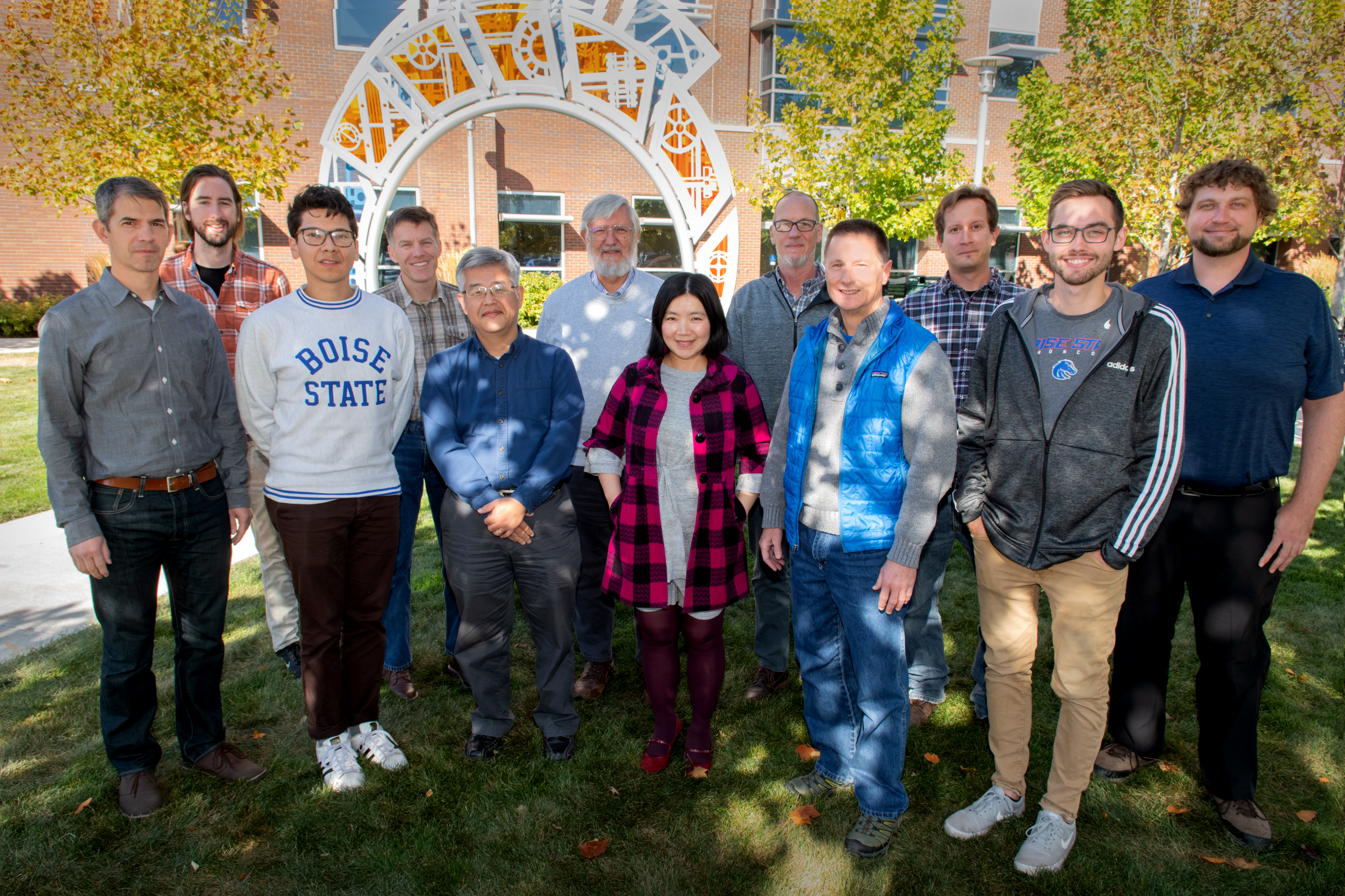 Team of researchers pose for outside portrait