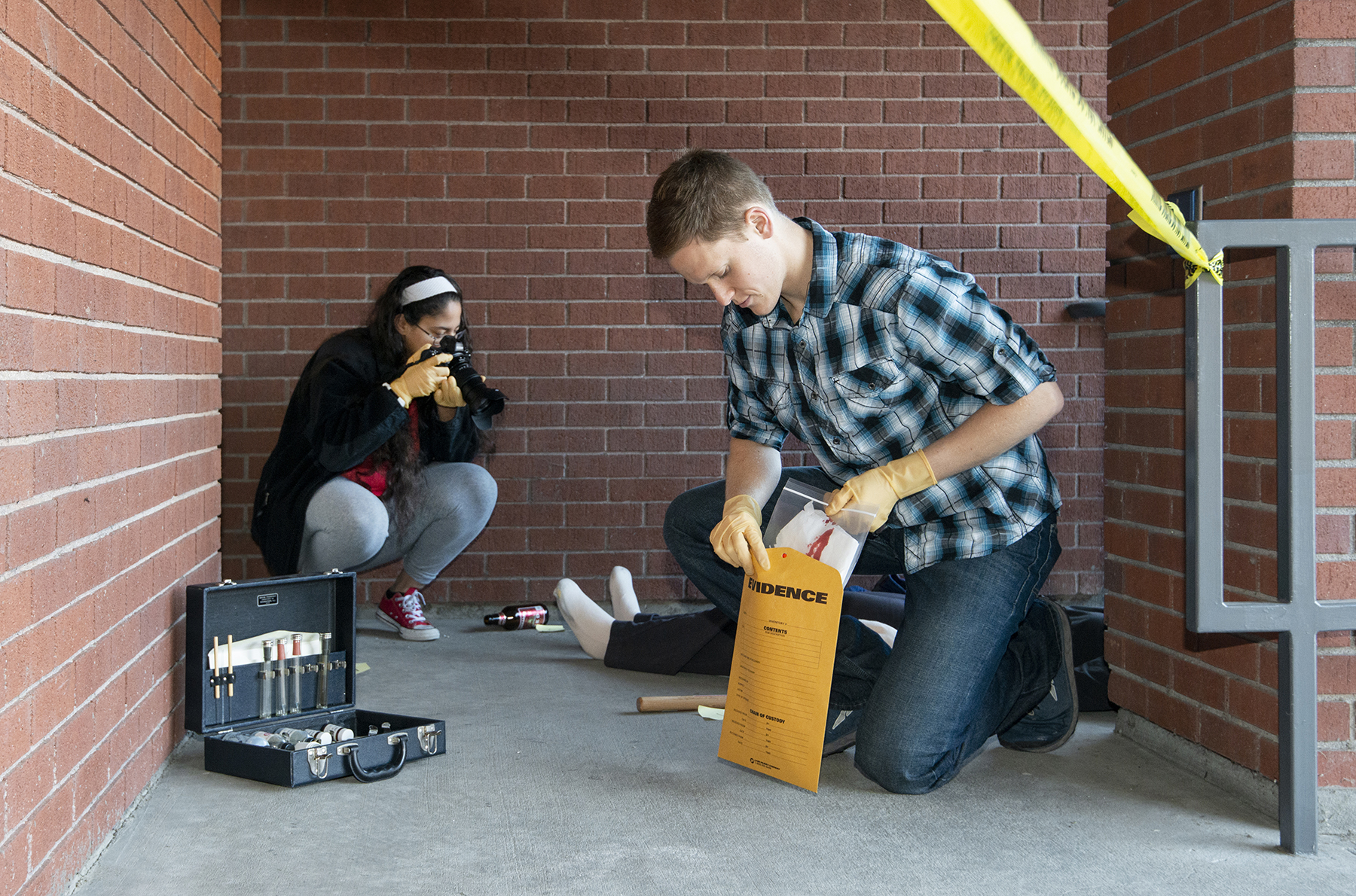 Two students stage a crime scene
